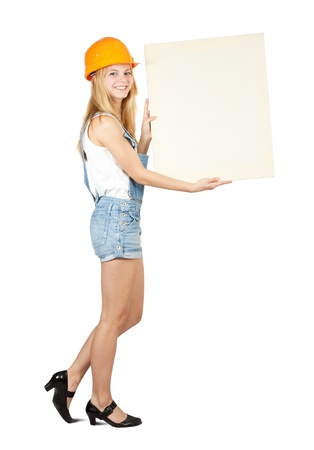 Female housebuilder holds blank canvas. It is isolated on a white background  photo
