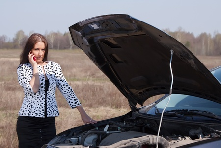 middle age woman calling by mobile near  her broken car Stock Photo - 9547853