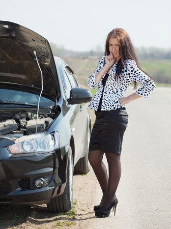 middle age  woman waiting support near  her broken car Stock Photo - 9547918