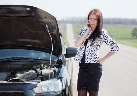 cowl: middle age  woman waiting support near  her broken car