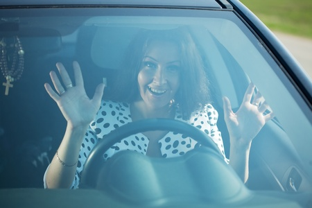 fright female driver inside her car photo