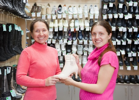 Two women chooses shoes at shoes shop Stock Photo - 9577269