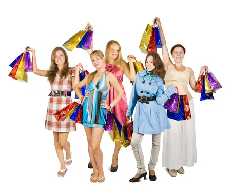 Group of girls holding shopping bags. Isolated in full length on white background Stock Photo - 9578608