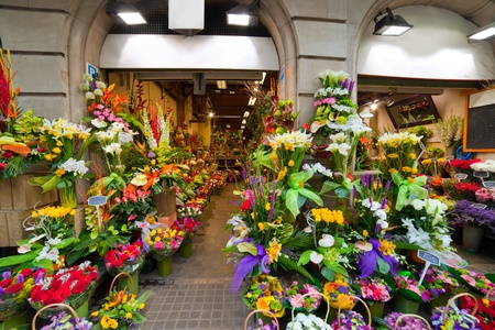 sidewalk sale: Flower shop in Old town of Barcelona, Spain, Europe Stock Photo