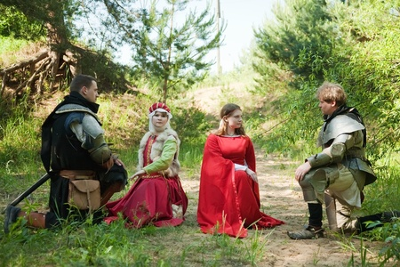 Two young medieval couple,  soldiers in armour  and women photo