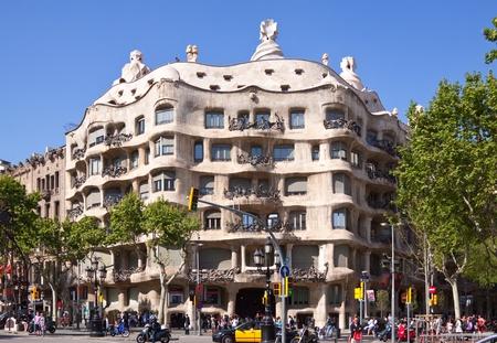 BARCELONA, SPAIN - APRIL 12: People before  La Pedrera in April 12, 2011 in Barcelona, Spain. Casa Mila (La Pedrera) built in 1905�1910 by  Catalan architect Antoni Gaudi