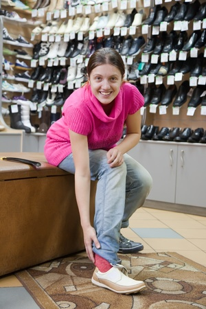 Woman trying shoes  for size  at shoes shop Stock Photo - 9579162