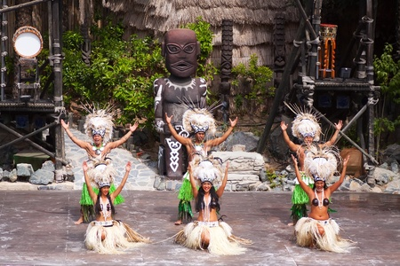 theme park: SALOU, SPAIN - APRIL 13:  Port Aventura theme Park in April 13, 2011 in Salou, Spain. Dansers performance traditional show at Polynesian area