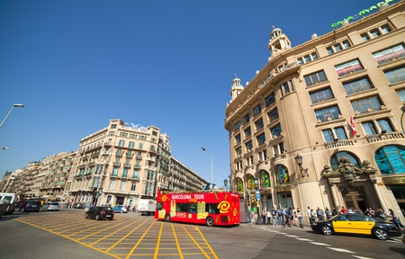 BARCELONA, SPAIN - APRIL 12: Tourists bus driving at Catalonia square in April 12, 2011 in Barcelona, Spain. It is one of famous place in Barcelona.
