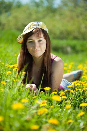 sunspot: Outdoor portrait of smiling woman in cap
