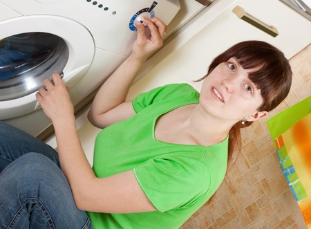 Beautiful women loading the washing machine. Cleaning and Laundry Stock Photo - 9676220
