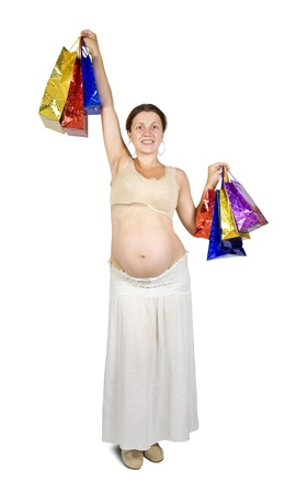 8 months pregnancy: pregnant woman with shopping bags