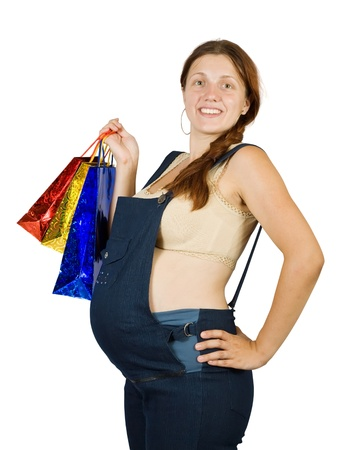 8 months pregnancy: pregnant woman with shopping bags over white Stock Photo