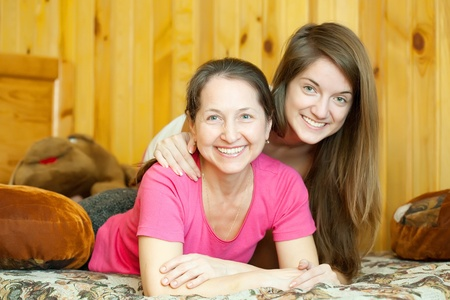 appy mother with her teenager daughter in home interior Stock Photo - 9676359