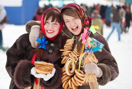 Two happy girls plays during Shrovetide at Russia photo