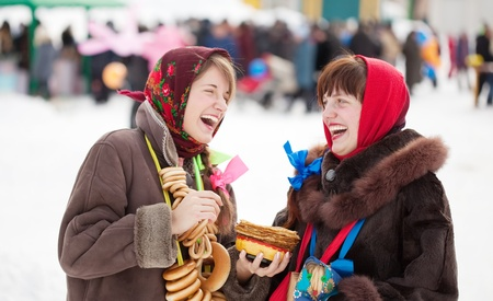 sudarium: Two happy girls celebrating  Shrovetide  at Russia Stock Photo