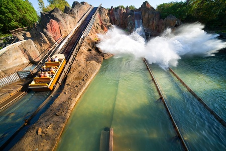 exhilarating: SALOU, SPAIN - APRIL 11: People riding in Theme Park in April 11, 2011 in Salou, Spain. Tutuki Splash is one of most exhilarating rides in Polynesian area  at Port Aventura