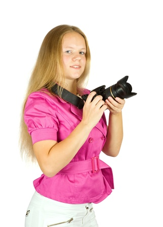 Young female photographer with camera over white background photo