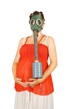 gasmask: Ritratto di donna incinta 9 mesi in maschera antigas over white Archivio Fotografico