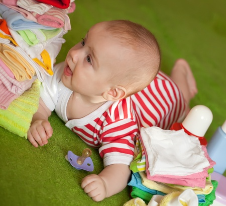 5 months baby girl laying on green blanket Stock Photo - 9766352
