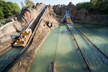 port aventura: SALOU, SPAIN - APRIL 13: People riding in Theme Park in April 13, 2011 in Salou, Spain. Tutuki Splash is one of most exhilarating rides in Polynesian area  at Port Aventura
