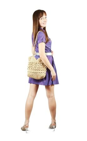 girl with handbag standing on white background