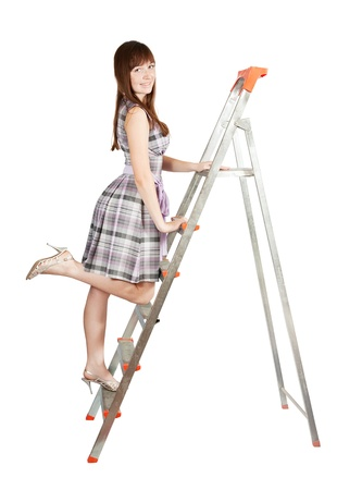 Sexy girl in checked dress on stepladder over white Stock Photo