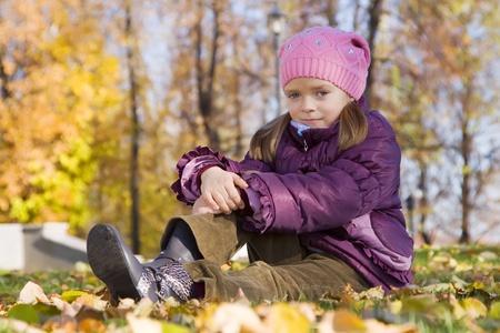 Portrait of little girl against autumn nature photo