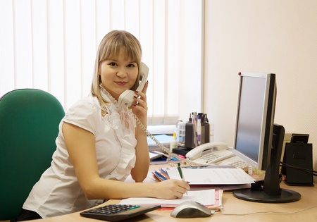Portrait of businesswoman  speaking by phone in office Stock Photo - 9854107