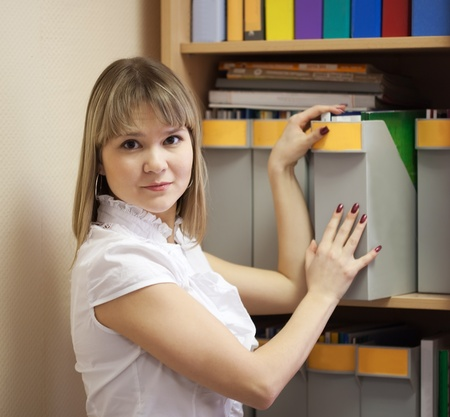 Young businesswoman with documents  working in office room Stock Photo - 9854111