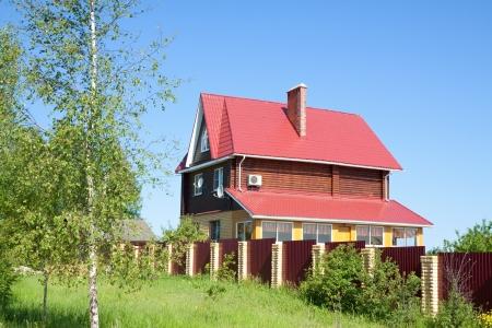 maisonette: log cottage in sunny summer day