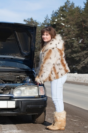 Woman waiting support near  her broken car photo