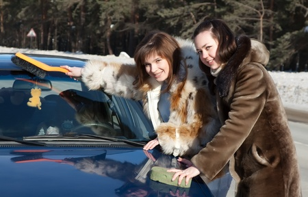 Two women cleaning car and looking at camera Stock Photo - 9854340