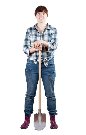 agriculturalist: Happy young  woman stands with spade over white Stock Photo