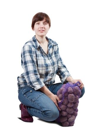 Happy  woman  with harvested potatoes over white photo
