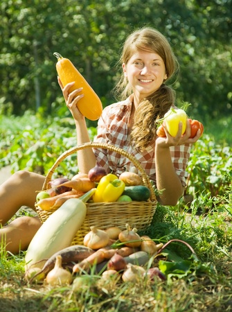 Teenage girl with  basket of fruits and vegetables