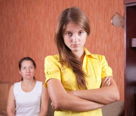 Mature mother and teenager daughter after quarrel at home Stock Photo - 9854612