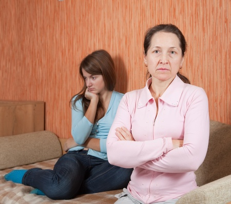 rebellious: Mother and teen daughter having quarrel at home