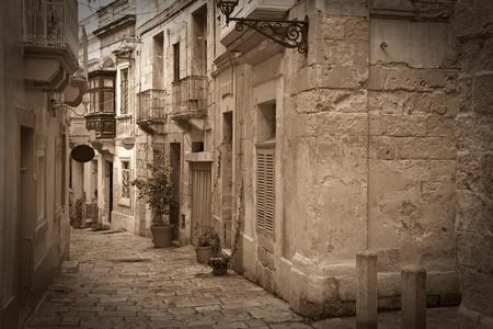 malta: Retro photo of old narrow  street of european town (Valletta, Malta) Stock Photo