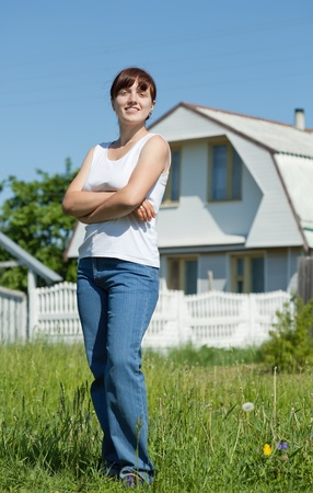 Happy young woman posing in front of her  residence Stock Photo - 9854661