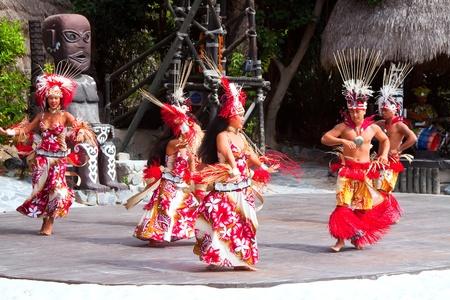 port aventura: SALOU, SPAIN - APRIL 13:  Port Aventura theme Park in April 13, 2011 in Salou, Spain. Dancers performance traditional show at Polynesian area