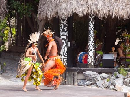 SALOU, SPAIN - APRIL 13:  Port Aventura theme Park in April 13, 2011 in Salou, Spain. Dancers performance traditional show at Polynesian area Stock Photo - 9777111