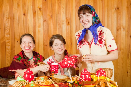 Women drinks tea with pancake during  Shrovetide Stock Photo - 9854817