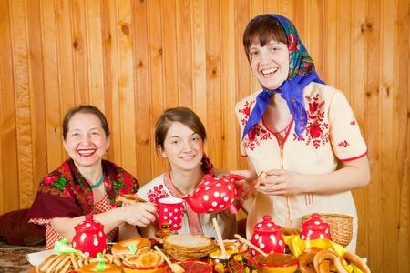 Women drinks tea with pancake during  Shrovetide Stock Photo - 9854817