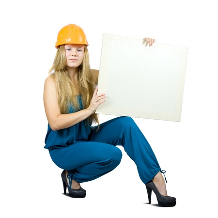 Girl in hardhat holding banner, isolated on white  photo