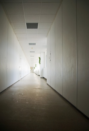 Very long corridor in business center with many offices photo