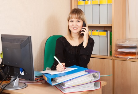 habitual: female  manager speaking by two phone in office