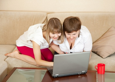wonder women looking to laptop in home Stock Photo - 9854876