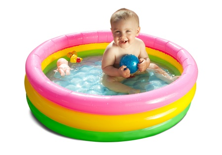Baby swimming  in kid inflatable pool, isolated on white background photo