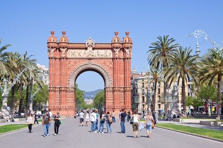 BARCELONA, SPAIN - APRIL 12: Tourists walking at Passeig de Lluis Companys in April 12, 2011 in Barcelona, Spain. Arc de Triomf was built for the Exposicion Universal de Barcelona (1888)